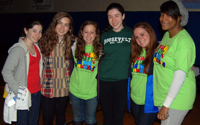 JCC teen director Mallory Saks, second from right, relaxes with participants in the Come ALIVE in the Community program on Sunday, from left, Abbie Goldring, Dara Levy, Maddie Rosenberg, Ilana Rood, and Niga Jacques. Photo by Elaine Durbach