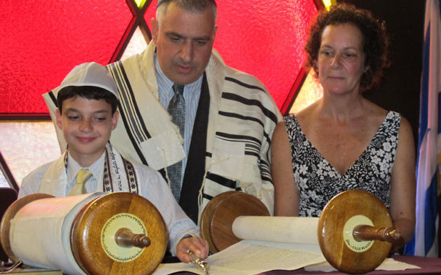 Josh Moreines, here with his parents Theo and Susan, at a practice for his bar mitzva ceremony, overcame the challenges of his autism to learn Hebrew and read Torah.