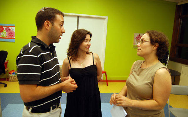 Rabbi Ben Goldstein, Leslie Klieger, center, and Adrienne Fitzer discuss plans to launch a Jewish day school in Union County. Photos by Elaine Durbach
