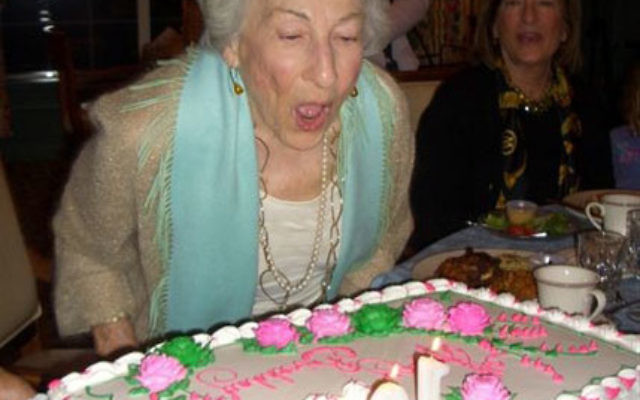 Edith Rose shows she has plenty of breath to spare as she blows out the candles on her 100th birthday, Dec. 10. Photo courtesy Gale Kobray