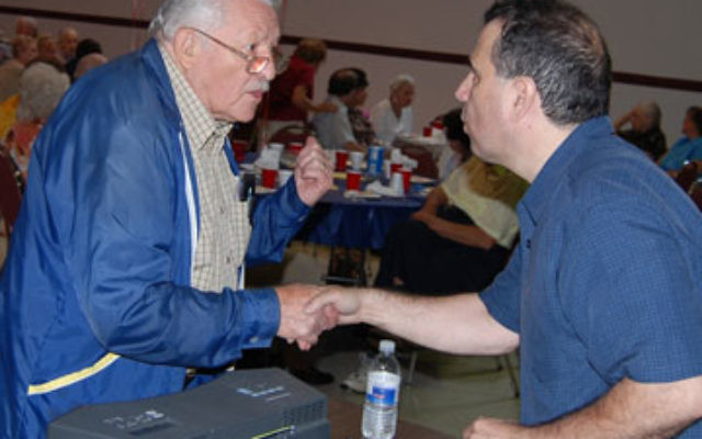 Tenor Salvatore Chiarelli, right, gets a big thank-you from opera lover Sam Odinsky after he sang for seniors at a Welcome Back lunch at the Union Y.
