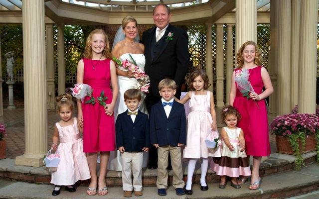 At their wedding in October, Karen Foster-Shenman and Joel Shenman with their respective grandchildren.