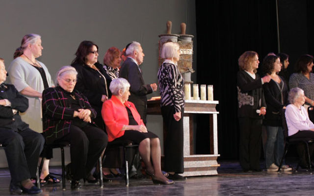 Holocaust survivors, accompanied by family members, were the honored guests at the Yom Hashoa event at Kean. Photos by Methodigm LLC