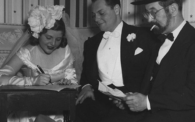 Dorothy Bleiweis and Harold Janoff on their wedding day in 1947. The event was held at the Janoff family's Alpine Caterers in Newark. Seated at right is Rabbi Louis Weller. Photos courtesy Janoff Family