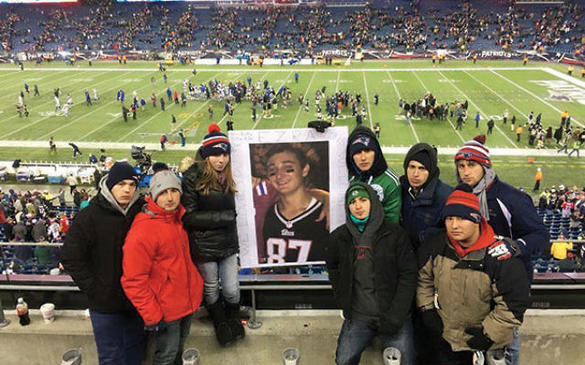 Ezra Schwartz's friends at a football game between the New England Patriots and the Buffalo Bills just four days after he was murdered. The Patriots held a moment of silence in memory of Ezra, a passionate fan, prior to the game.