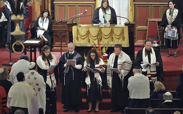 Members of the 2016 rabbinical class of the Hebrew Union College-Jewish Institute of Religion read their class prayer at an ordination ceremony at the Plum Street Temple in Cincinnati, May 21, 2016.