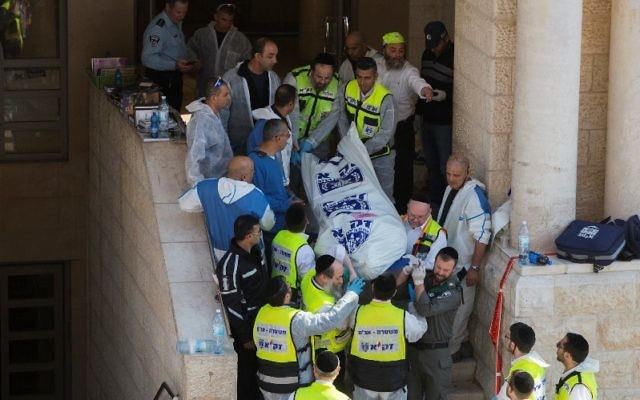 The scene at a deadly Jerusalem synagogue terrorist attack, which Secretary of State John Kerry blamed on Palestinian incitement, Nov. 18, 2014. (Yonatan Sindel/Flash90)