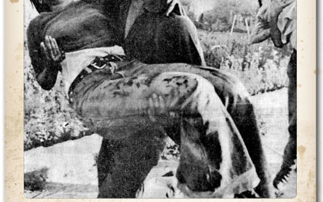 In this iconic photo, Tzipi Maimon-Bokris is saved by her brother after being injured by a grenade at the Netiv Meir school building in Ma'alot, Israel, May 15, 1974. Photo courtesy Their Eyes Were Dry