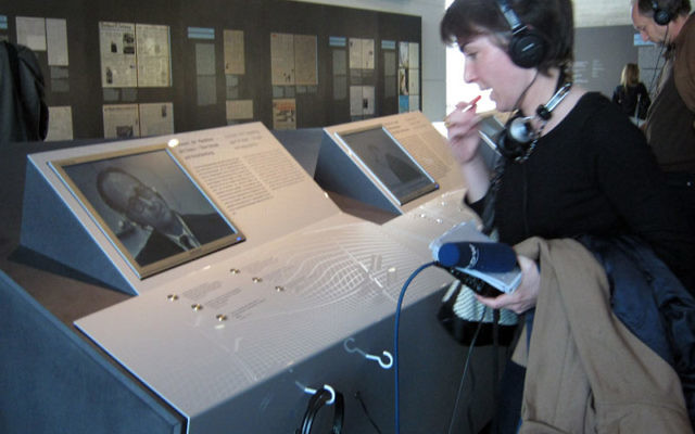 A visitor previewing the new Eichmann exhibition in Berlin listens to an excerpt of Eichmann's testimony. Photo by Toby Axelrod