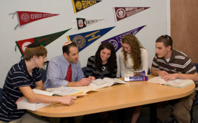 Gary Berger, seen here counseling students at Rae Kushner Yeshiva High School, has started a national network to gather information on which colleges are the most hospitable to Jewish students.