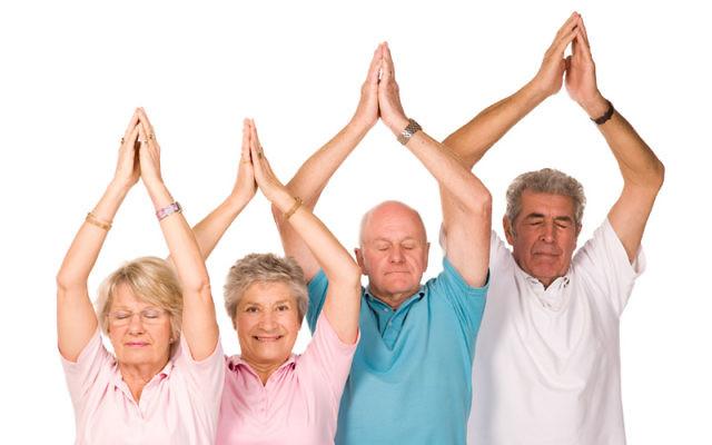 Seniors practicing yoga.