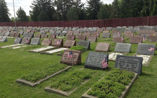 Flags planted by Jewish War Veterans of the United States Cleveland Post 14 at Zion Memorial Park in Bedford, Ohio, in honor of Memorial Day, 2015. Jewish War Veterans of the United States, via Facebook