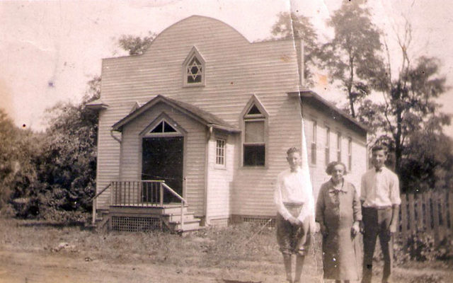 The oldest known picture of the Perrineville Jewish Center, then known as The First Hebrew Farmers Association. It was believed to have been taken in 1926, on the occasion of the bar mitzva of one of the Abramowitz brothers, Issac and Sidney, who are sh