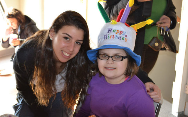 Hannah Glass celebrates her 12th birthday with Hand in Hand teen volunteer Odette Ades of Eatontown.