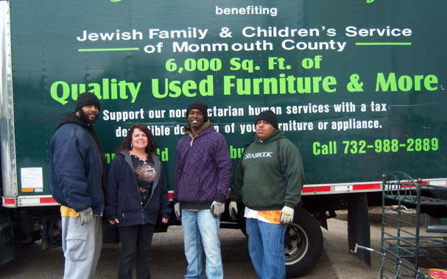 Jewish Family & Children's Service of Monmouth County delivery trucks will now bring much-needed goods to families in neighboring Ocean and Middlesex counties. Cathy Childers, who oversees the delivery process for JF&CS, with drivers/movers,