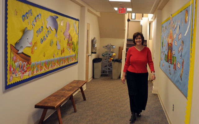 Stella Jeruzalmi Stanway, principal of the school at Temple Beth Miriam, walks down the hall of the newly renovated education wing at the Elberon synagogue.
