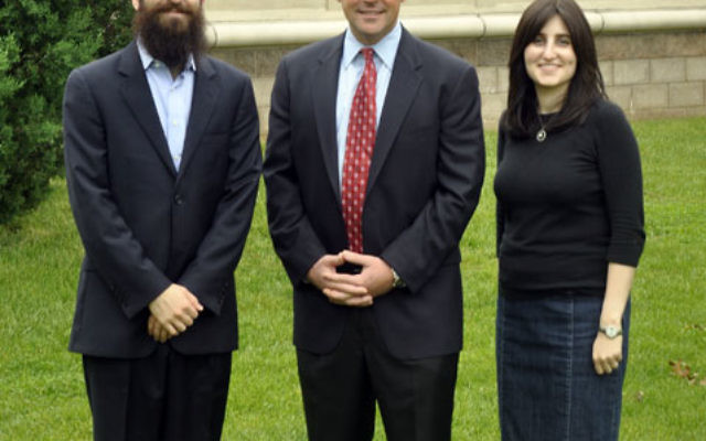 Rabbi Yossi and Dina Kanelsky flank Marlboro Mayor Jonathan Hornik May 22 in front of the Center for Jewish Life.