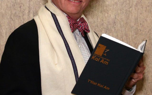 """Rabbi Brooks Susman, with help from Congregation Kol Am congregants, created the appropriately named """"Voice of the People"""" prayer book. Photo by Allan Goldberg/www.CoachmanStudios.com"""