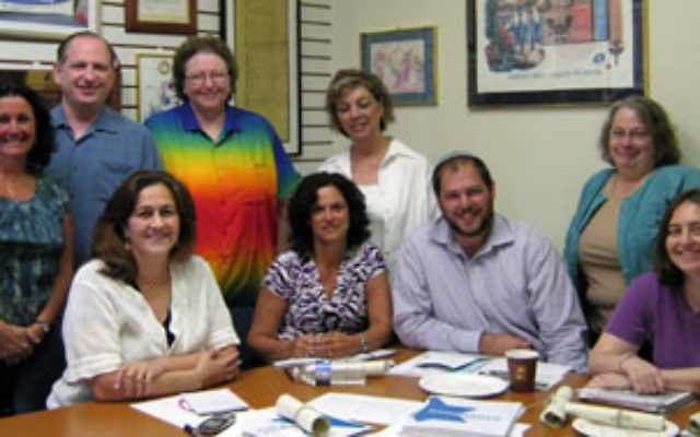 At a CJE meeting are area Reform and Conservative synagogue education directors along with cochairs Ann Gabel, far left, and Dina Maiben, third from left.