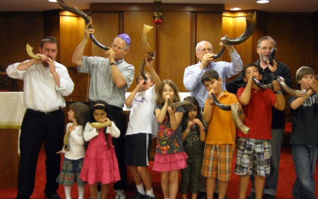 Richard Sachs, rear, third from left, organizer of the first-ever Shofaron Aug. 30 at Monmouth Reform Temple, at the shofar-blowing contest last fall at Congregation Beth Shalom in Red Bank, where he took Longest, Most Traditional, and Most Melodious hono