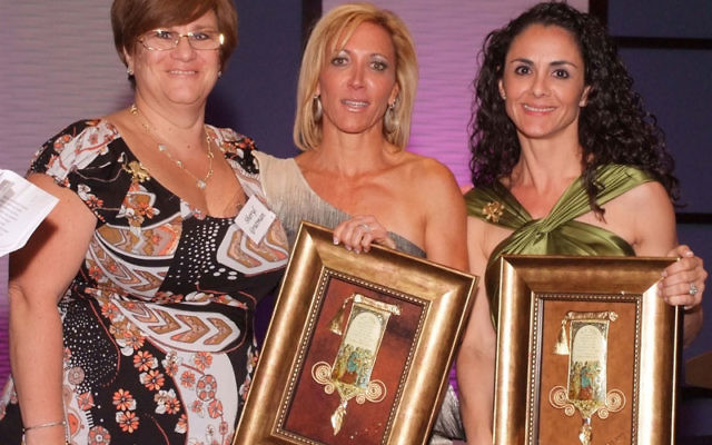 Main Event honorees Lauren Reich, center, and Chris Katz, right, receive their awards from Women's Philanthropy president Sheryl Grutman. Photos by Freehold Photography and Video