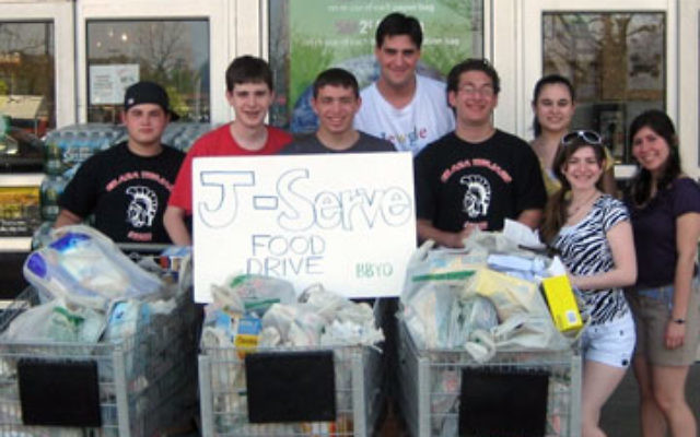 BBYO members collect food outside a supermarket.