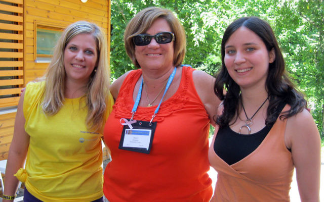 Sheryl Grutman, center, Women's Philanthropy president, visits with Jewish counselors at Camp Szarvas in Hungary.