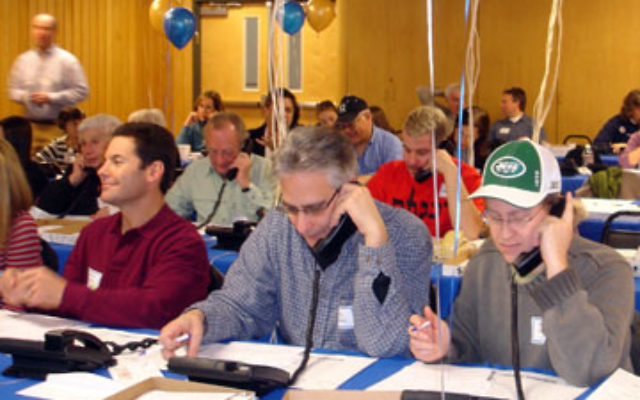 Volunteers work the phones at last year's Super Sunday fund-raiser.
