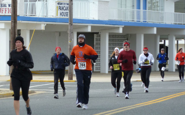 Rabbi Elie Tuchman runs the Ocean Drive Marathon, meeting a fitness challenge and raising funds for Yeshiva at the Jersey Shore.