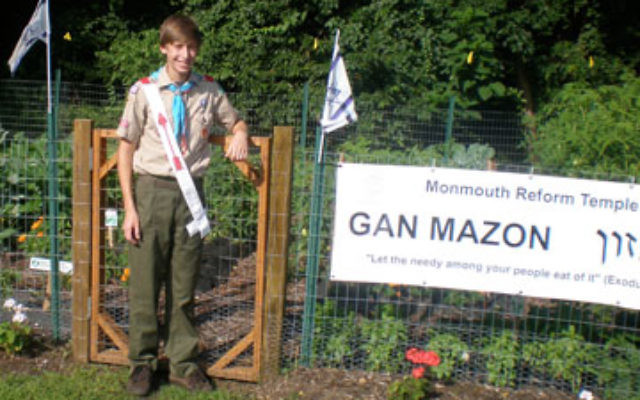 Eagle Scout Joshua Gilstein in front of Monmouth Reform Temple's Gan Mazon
