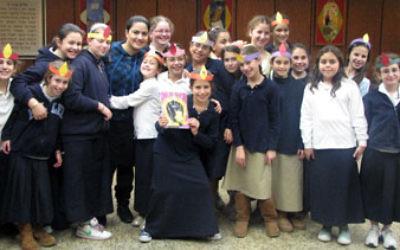 Sagit Moshe, fourth from left, and Merav Frenkel, rear, second from right, run a Rosh Hodesh program for the girls at Hillel Yeshiva in Ocean.