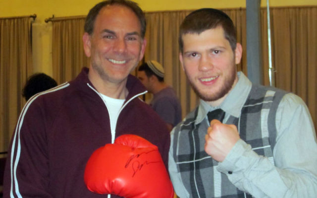 Champion boxer Dmitriy Salita, right, with Jeff Strumeier of Marc Ecko Enterprises at the May 4 event at Chabad of Western Monmouth County in Manalapan.