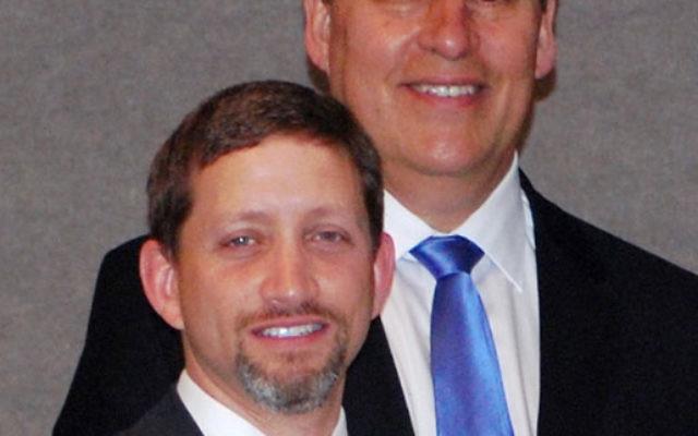 Rabbi Jonathan Roos, left, and the Rev. David McKirachan accept the Jersey Shore Humanitarian Award on April 29.