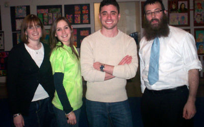 With Marc Elliot, second from right, are, from left, Friendship Circle director Chana'le Wolosow, FC volunteer coordinator Moushkie Chazanow, and Rabbi Levi Wolosow of the Chabad of Western Monmouth County.