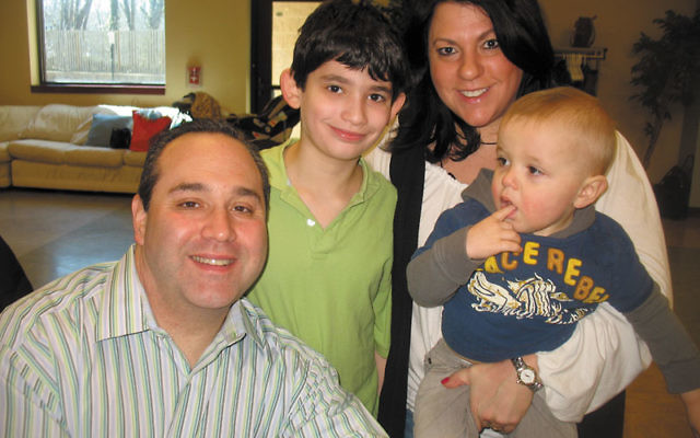 Lisa Marx — shown with her husband, Jason, and their children, Adam and Benji — helped found the adoption group at Congregation Agudath Israel of West Essex.
