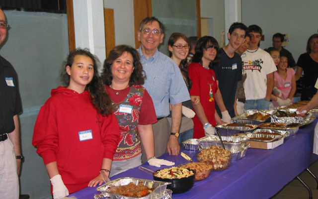 In 2009, Asekoff lends a hand — as he does every year — at B'nai Shalom's annual Memorial Day Soup Kitchen event at Christine's Kitchen.