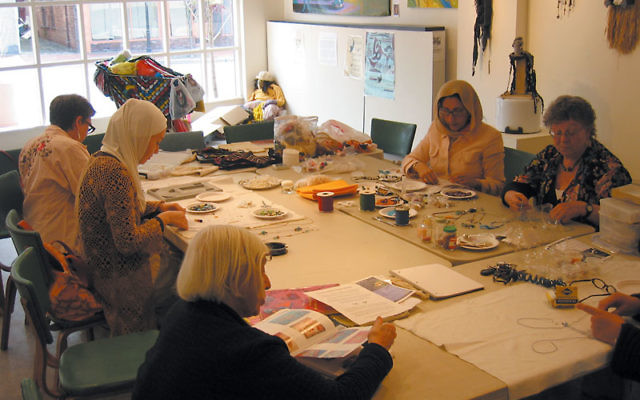 Maya Bloom leads a beading for peace workshop on Monday nights at the Maplewood 1978 Center through June 28. Photo courtesy Maya Bloom