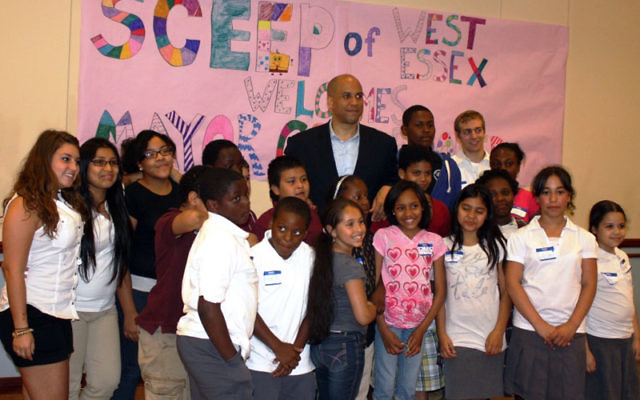 Mayor Cory Booker with the Newark SCEEP students during the May 27 program at Congregation Agudath Israel in Caldwell. Photos by Hugh Conway