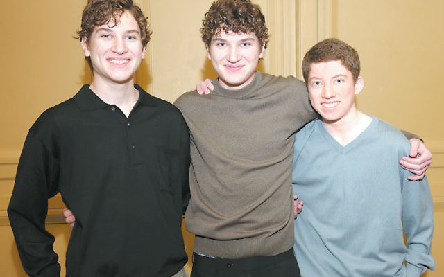 The Krieger sons, from left, Daniel, Eric, and Josh at a recent UJC MetroWest fund-raising event