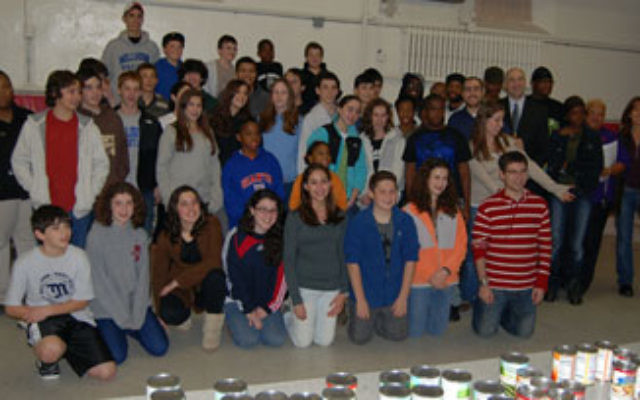 Teens and adults from Oheb Shalom Congregation join members of Franklin-St. John's United Methodist Church in Newark to pack Thanksgiving bags for needy families, as part of the community service of Etgar, the synagogue's teen group.
