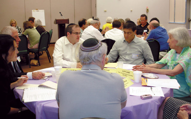 Representatives of the MetroWest, Central, and Northern NJ federations discuss the merger of their community relations councils at an August 2009 leadership retreat in Whippany.