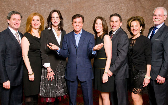 Bob Costas, center, is flanked by event chairs, from left, Zev Scherl and Rachel Braun Scherl; Paula Saginaw, UJA campaign chair; Susie and Peter Polow; and Linda and BJ Reisberg. Photo by Dave Hollander