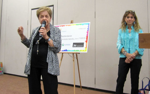 Milly Iris, left, speaks to the more than 110 who attended the 2011 Teen Tzedakah grant presentation about the importance of life-long giving as daughter Roree Iris-Williams, right, looks on.
