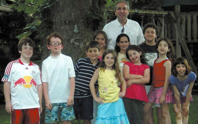 Cantor Perry Fine, whose 18th anniversary at Congregation Beth El will be celebrated June 6, with the synagogue's children's chorale, in 2008. Photo by Nomi Colton-Max