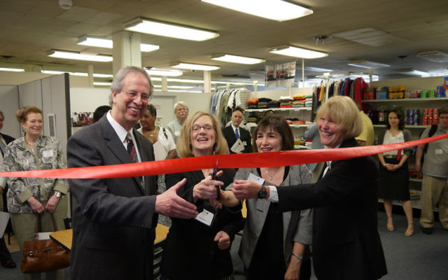 Cutting the ribbon at the dedication of the Jewish Vocational Service of MetroWest Career Center for individuals with Autism Spectrum Disorder are, from left, JVS executive director Leonard Schneider; NJ Division of Vocational Rehabilitation Services dire