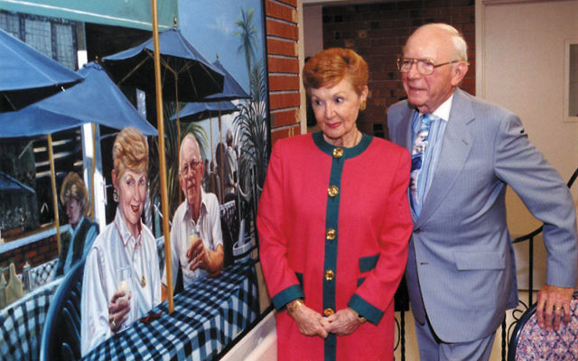 Lester H. Lieberman with his wife, Shirley, at the 1999 annual meeting of Daughters of Israel; their images are portrayed on a mural in the nursing home. Photo courtesy Jewish Historical Society of MetroWest