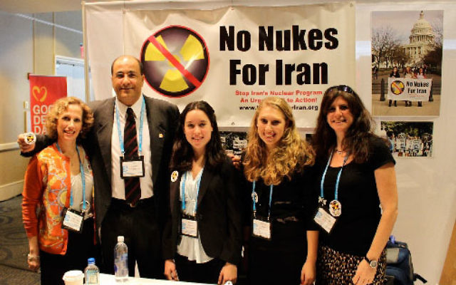 A No Nukes for Iran Teen Advocacy Program exhibit was on display at the General Assembly of the Jewish Federations of North America in New Orleans last week. With Ido Aharoni, acting consul general of Israel in New York are, from left, Nancy Kislin Flau