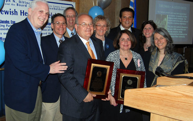 After the May 4 Stars of Essex County Award ceremony in Newark, the recipients, Roger Jacobs and Jacqueline Yustein, front row, center, pose with supporters, from left, Steven Klinghoffer, former, and Gary Aidekman, current, UJC president; Leonard Schneid