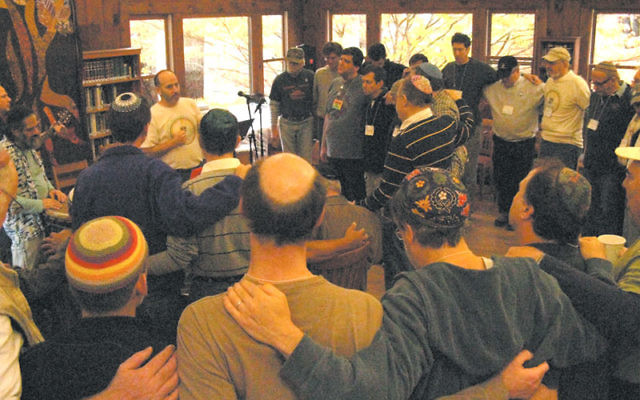 David Malchman of Morris Plains leads a Mi Shebeirach at the Jewish men's retreat at the Isabella Freedman Retreat Center. Malchman will cofacilitate this year's retreat, to be held Oct. 29-31. Photo courtesy David Malchman