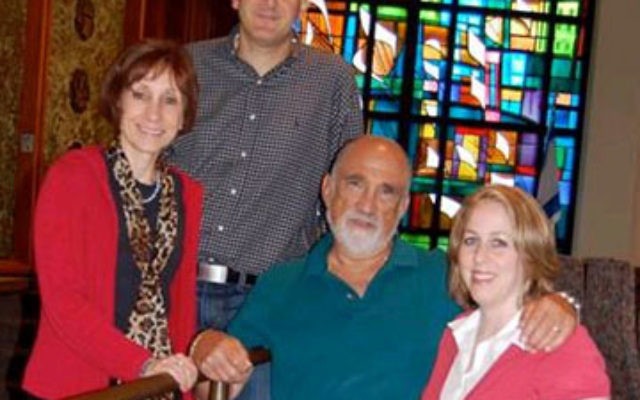 In the sanctuary at Temple Sharey Tefilo-Israel, the first area synagogue to meet MetroWest ABLE's requirements to be considered a fully accessible congregation, are, from left, Cantor Joan Finn, Rabbi Daniel Cohen, Cantor Ted Aronson, and Rabbi E